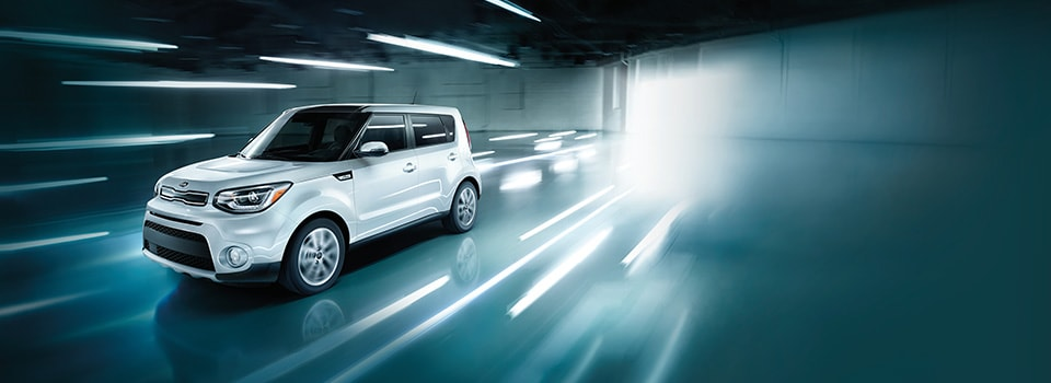 2019 Kia Soul driving through lights