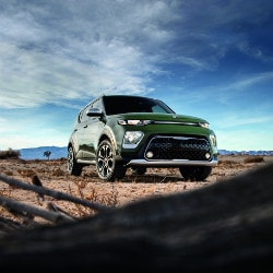 Green 2020 Kia Sportage in desert