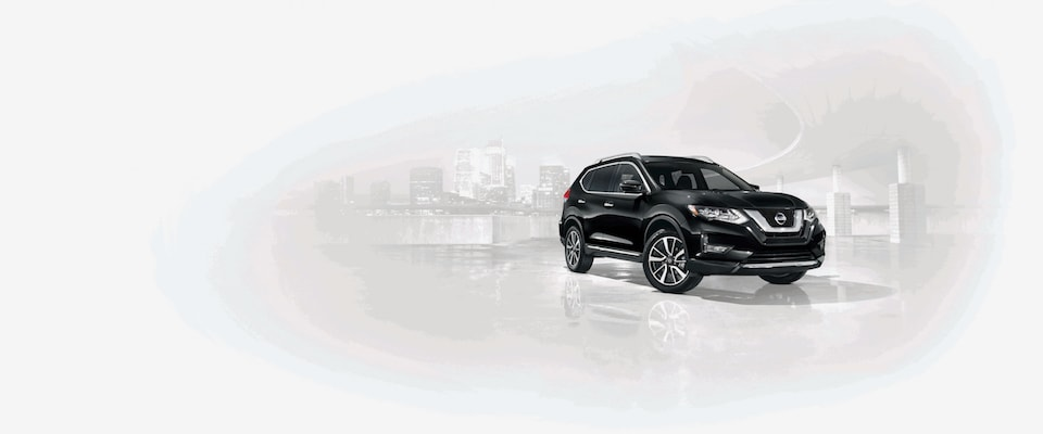 A black Nissan Rogue in front of a faded white city background