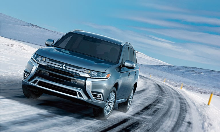 2019 Mitsubishi Outlander PHEV driving in snow