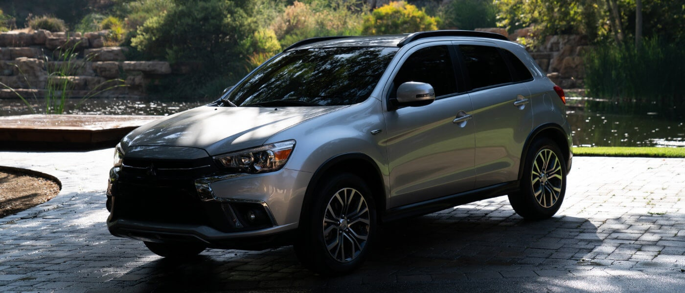 2019 Mitsubishi Outlander parked outside under a tree