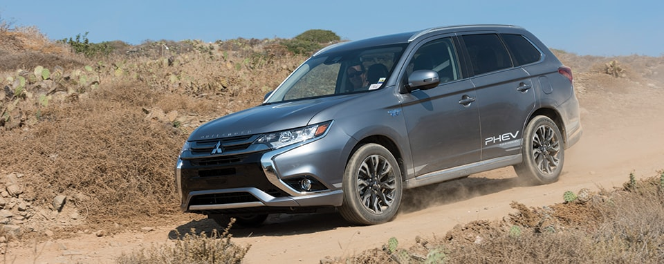 2018 Mitsubishi Outlander driving on dirt road