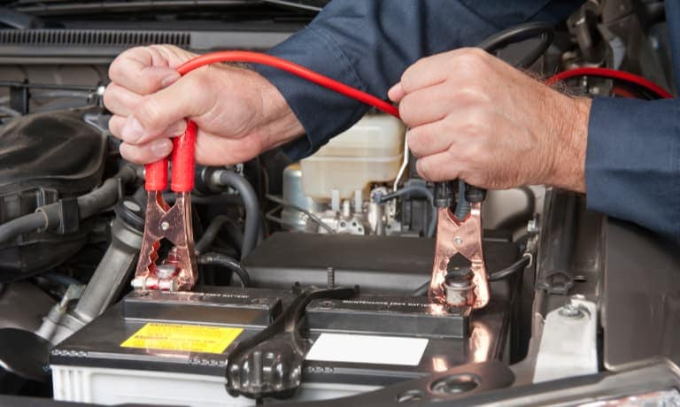 man testing car battery