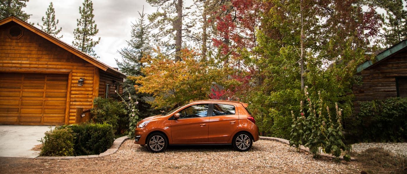 Orange 2019 Mitsubishi Mirage outside during fall