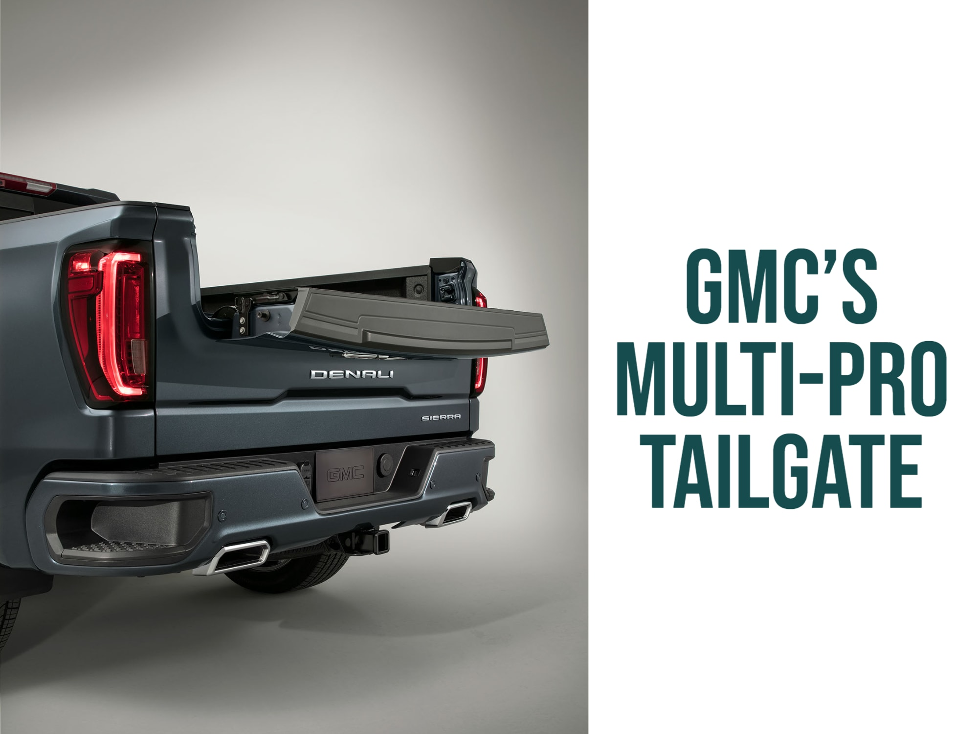"""View of MultiPro tailgate in bed extender position with words: """"GMC's Multi-Pro tailgate"""""""