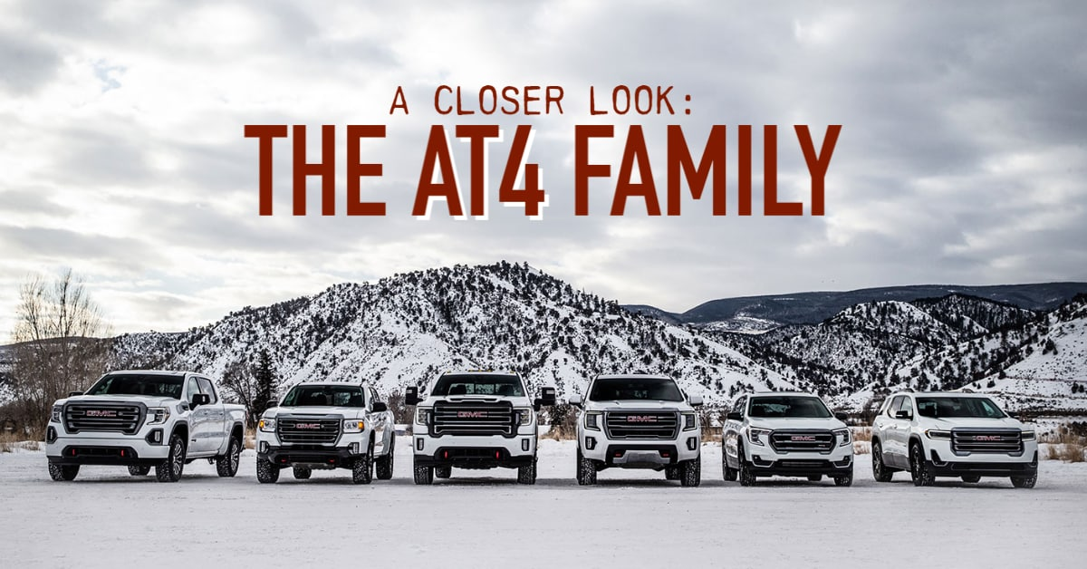 GMC AT4 lineup in front of snowy mountains