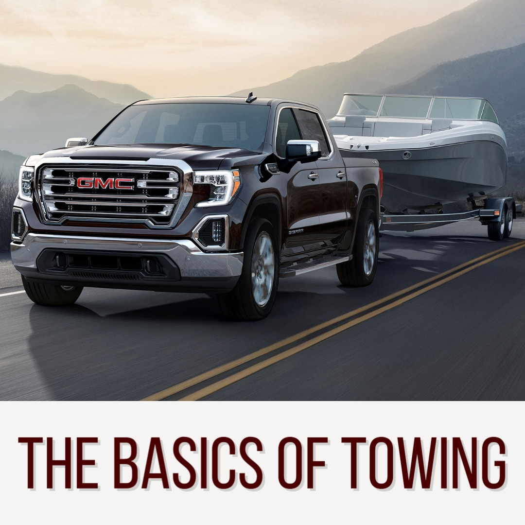 """GMC Sierra Towing a boat above words: """" The Basics of Towing"""""""