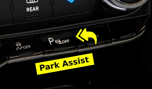 """Close up of Park Assist Button with Yellow Arrows Pointing and Yellow """"Park Assist"""" label"""