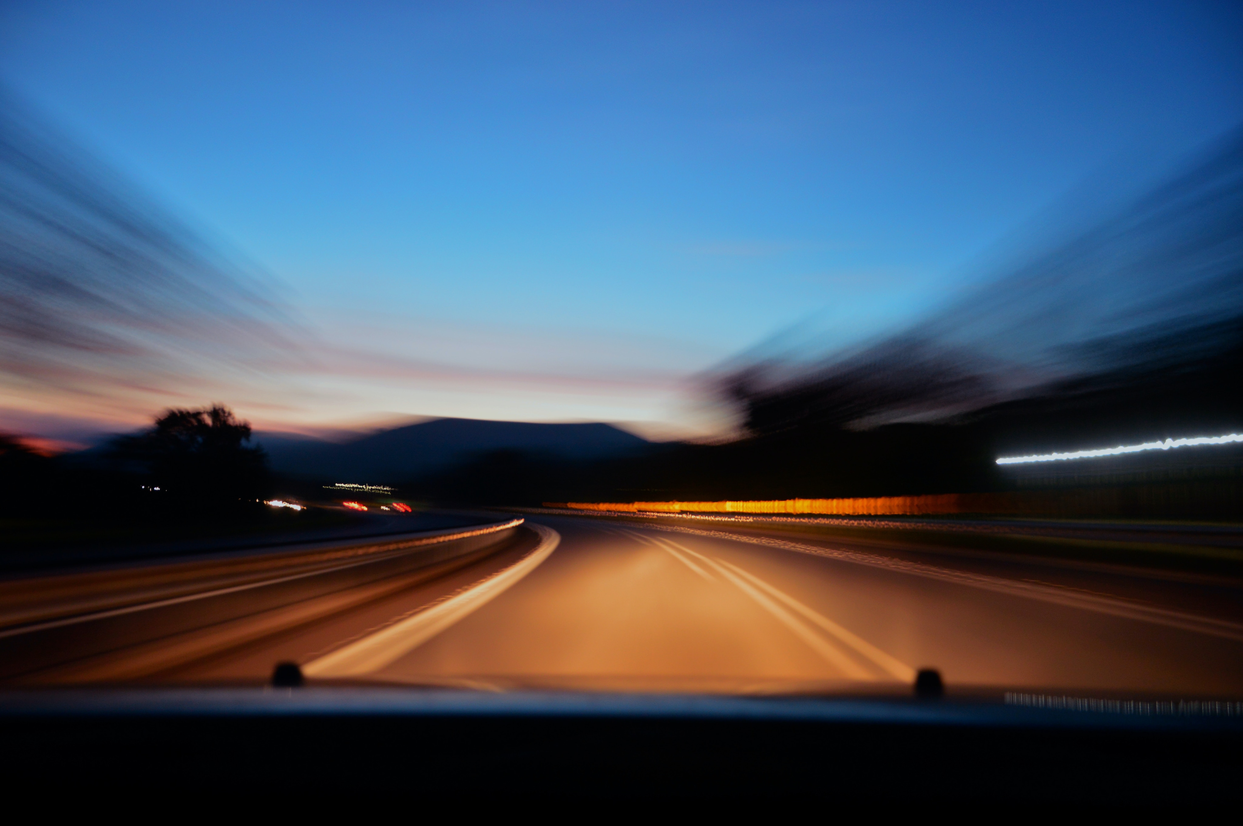 Dashboard view of driving on highway