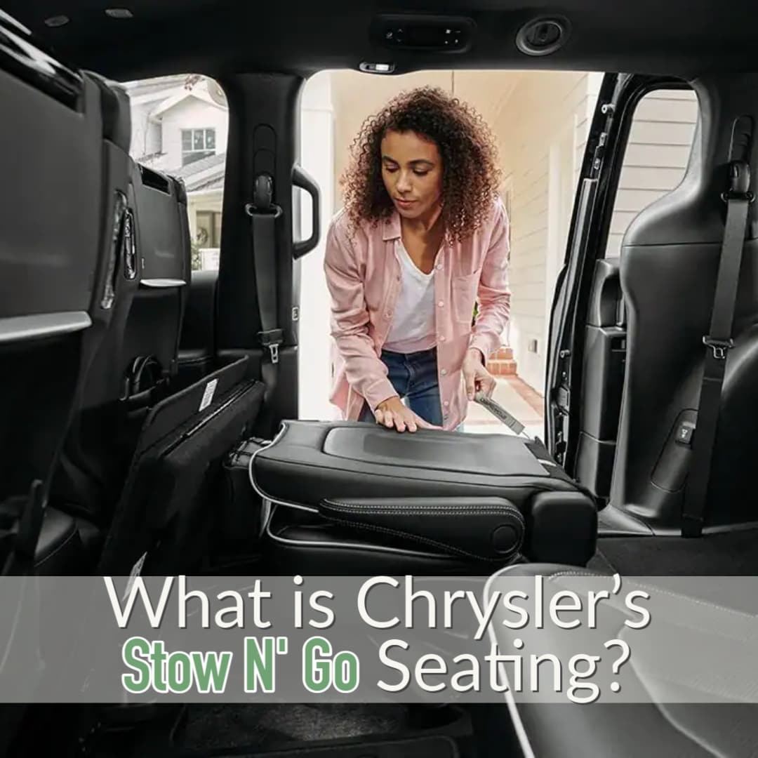 Person Folding Down Seats in Chrysler Minivan