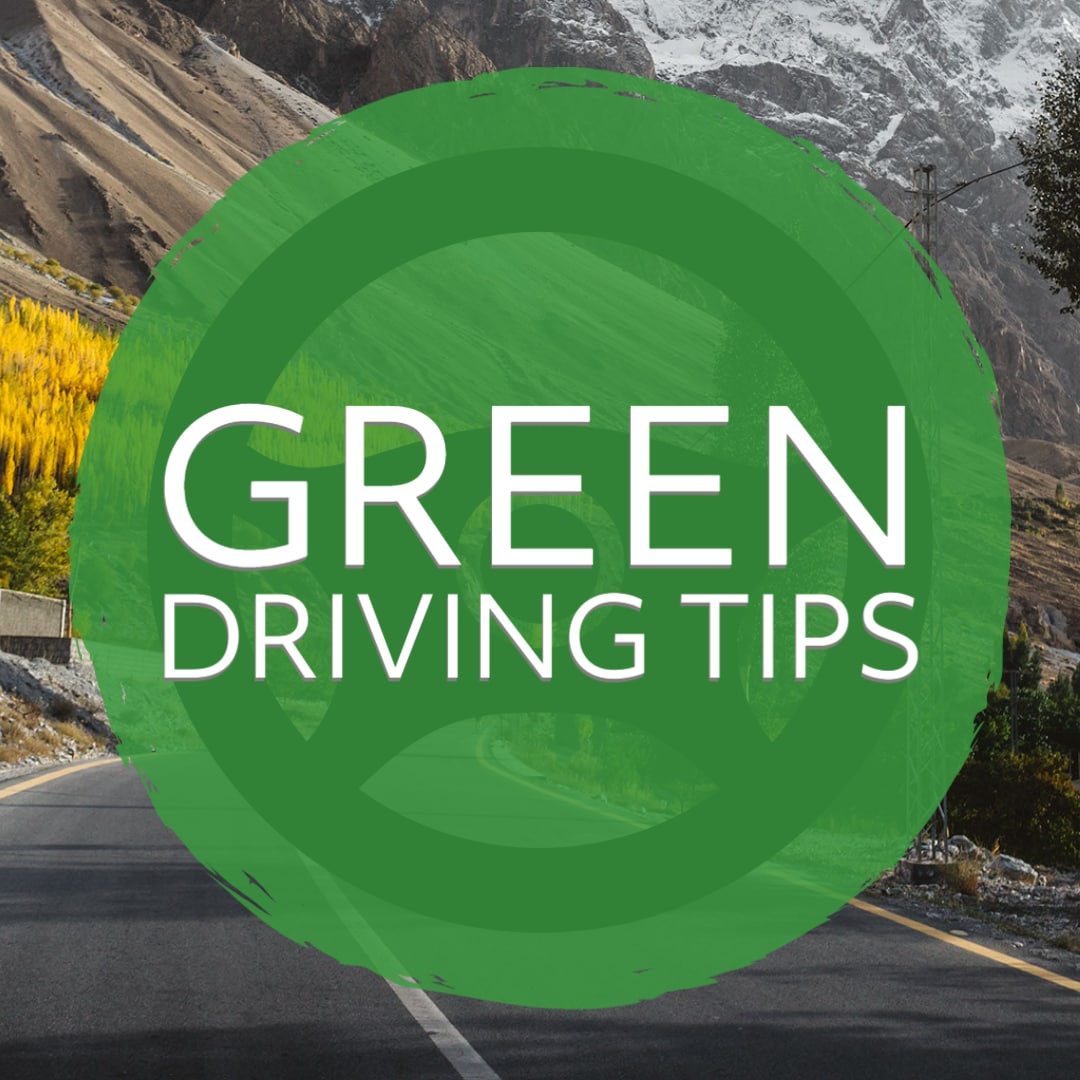 """White font """"Green Driving Tips"""" on green circle with mountainous background."""
