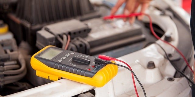 Service Technician checking a car battery for free