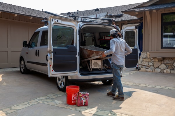 Person loading cargo into back of ProMaster City