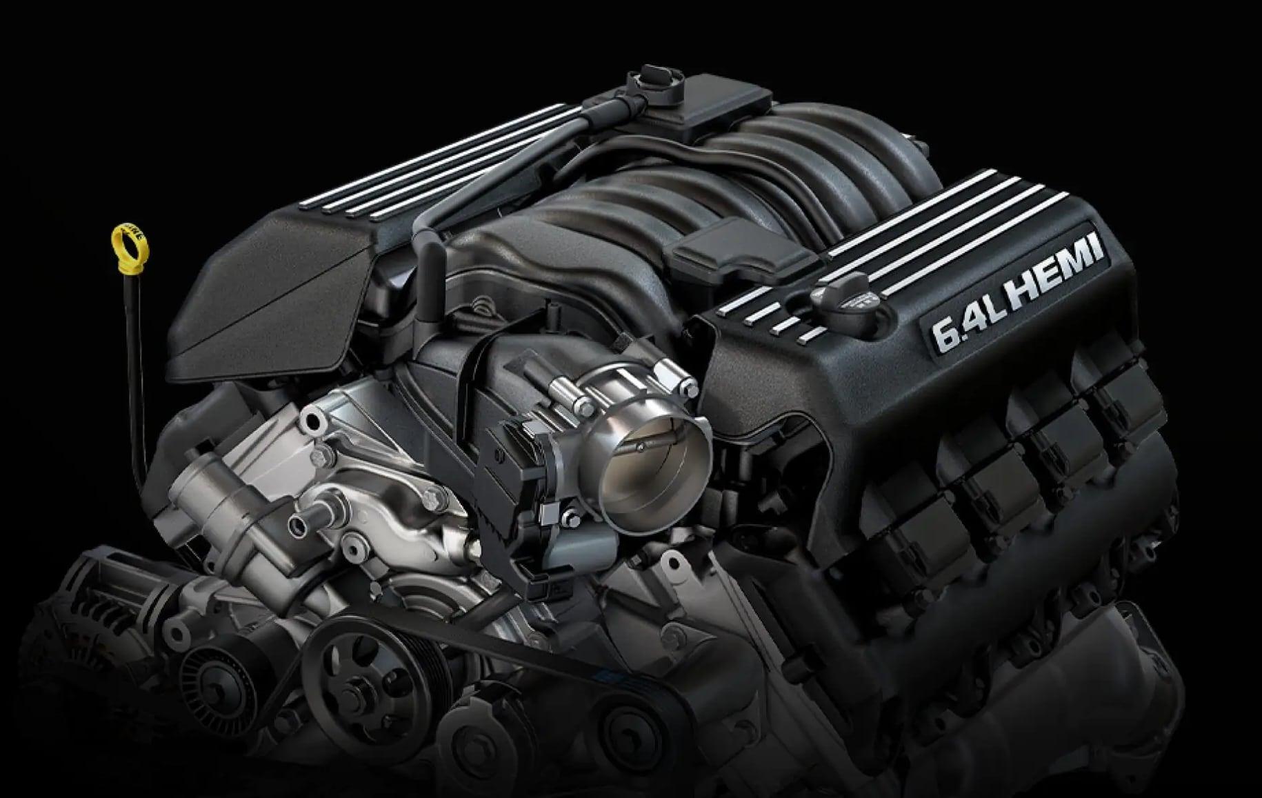 Close up of 6.4L Hemi V8 engine on black background