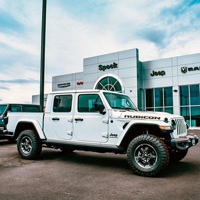 Speck Chrysler Jeep Dodge Ram facility exterior with a new 2020 Jeep Gladiator