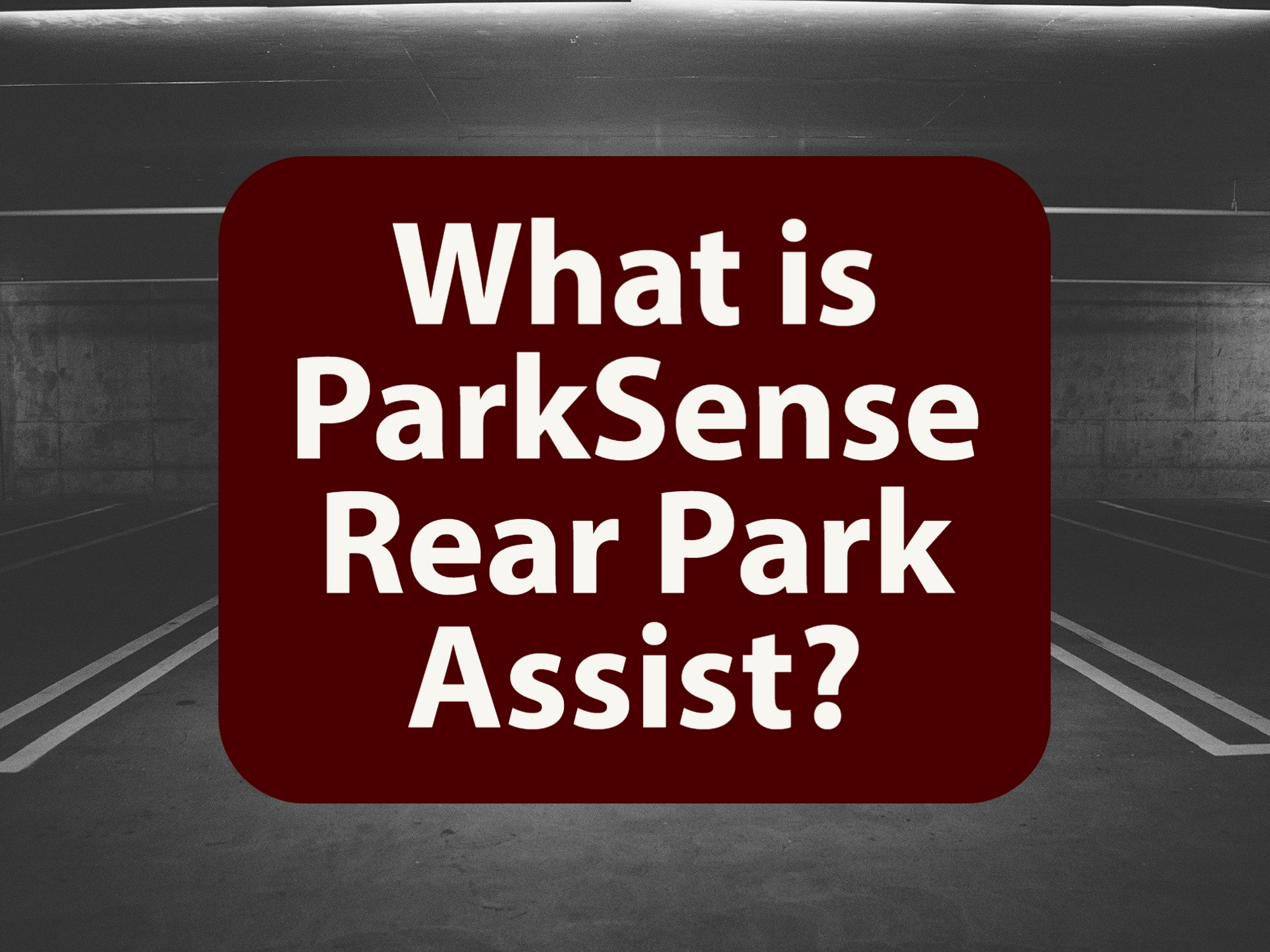 """Black and White Parking lot with words """"What is ParkSense Rear Park Assist?"""" in maroon-colored box"""