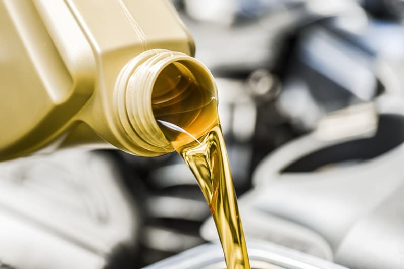 oil change image with oil pouring out of bottle
