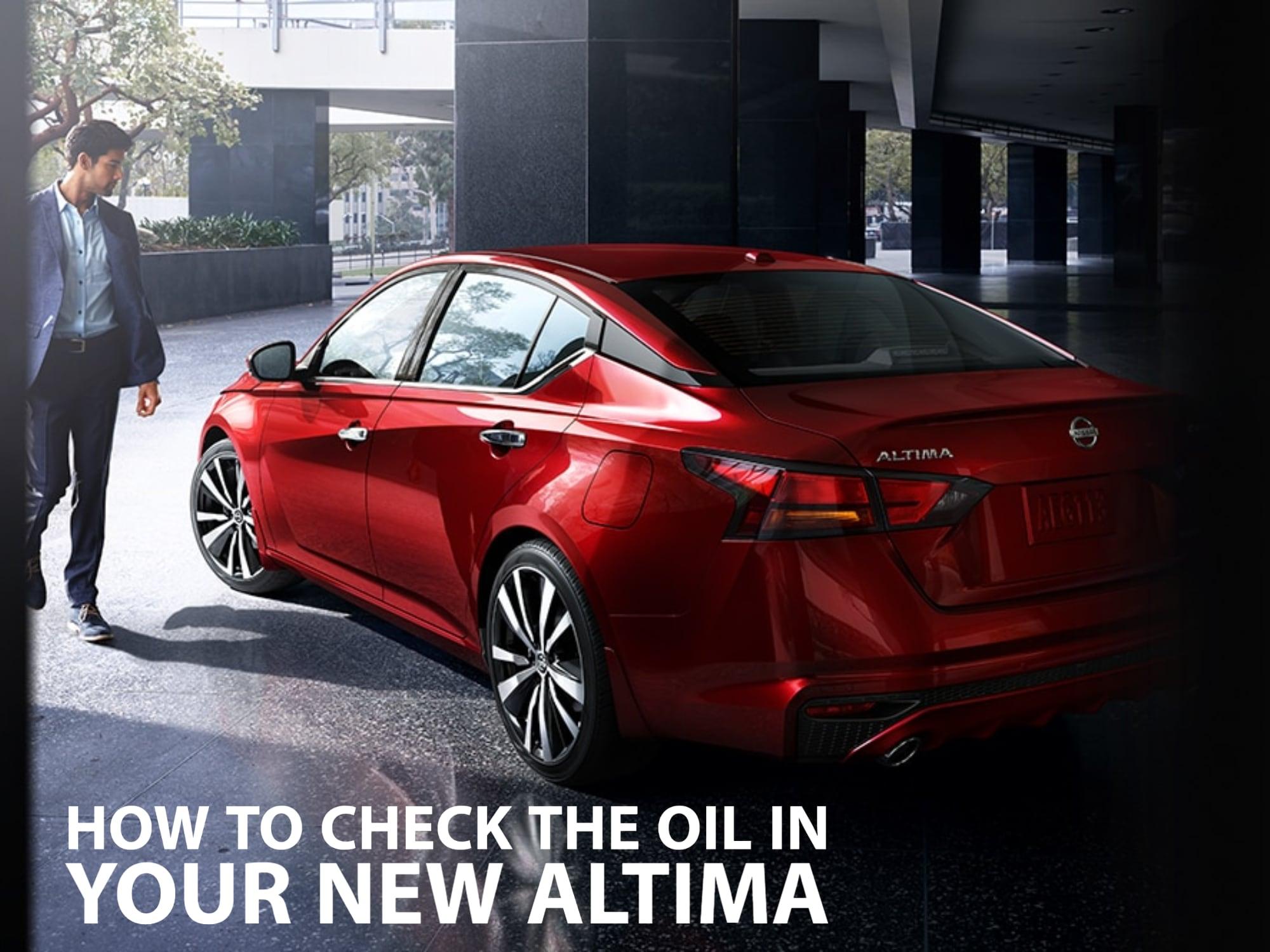 Guy walking around red Nissan Altima rear 3/4 view