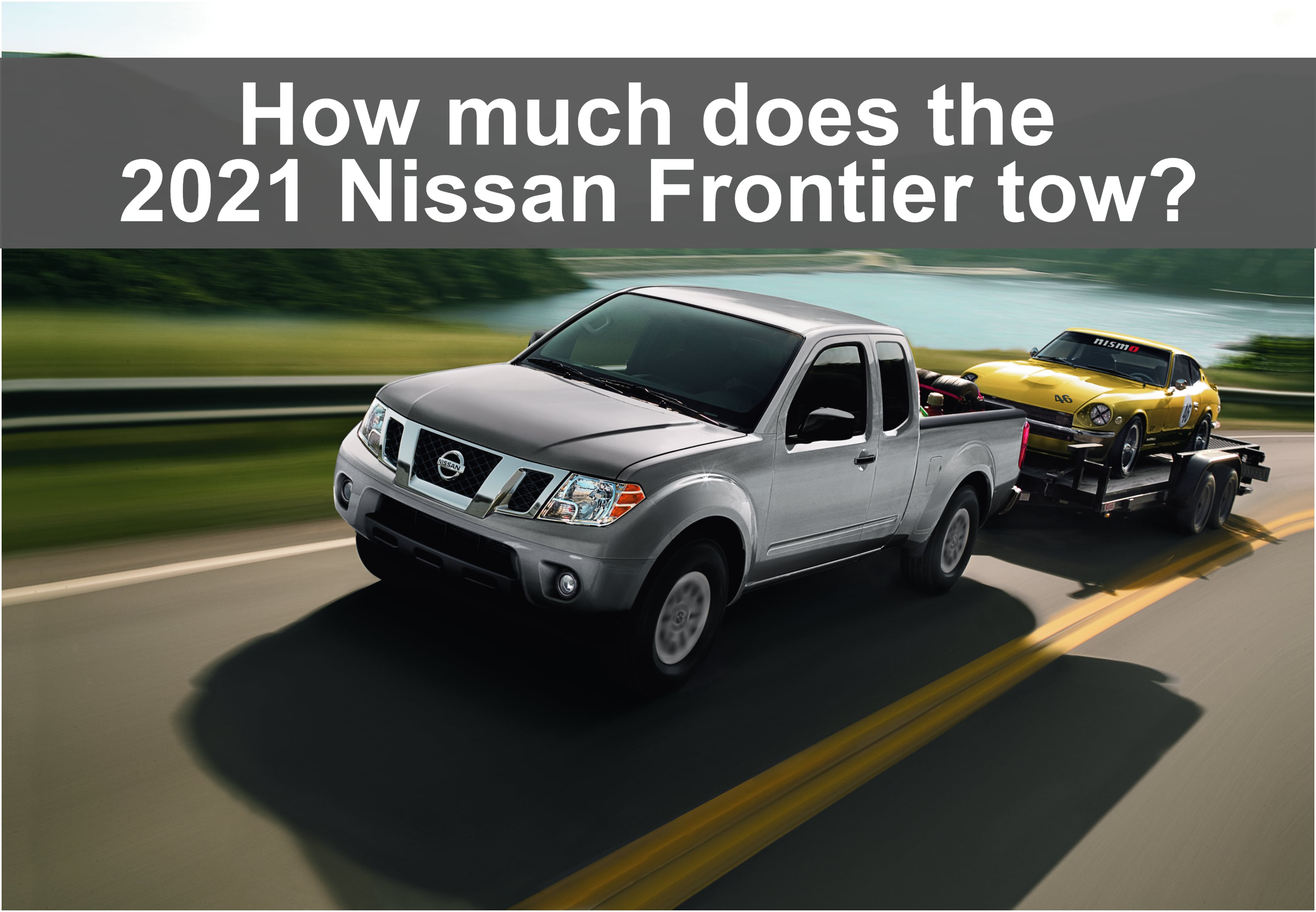 Driving View of Nissan Frontier towing vintage nissan