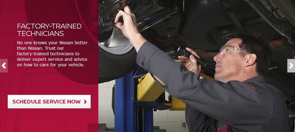 Certified Nissan autmotive technician working on a new Nissan
