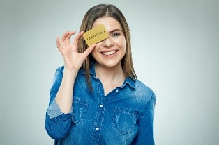woman holding a gold card