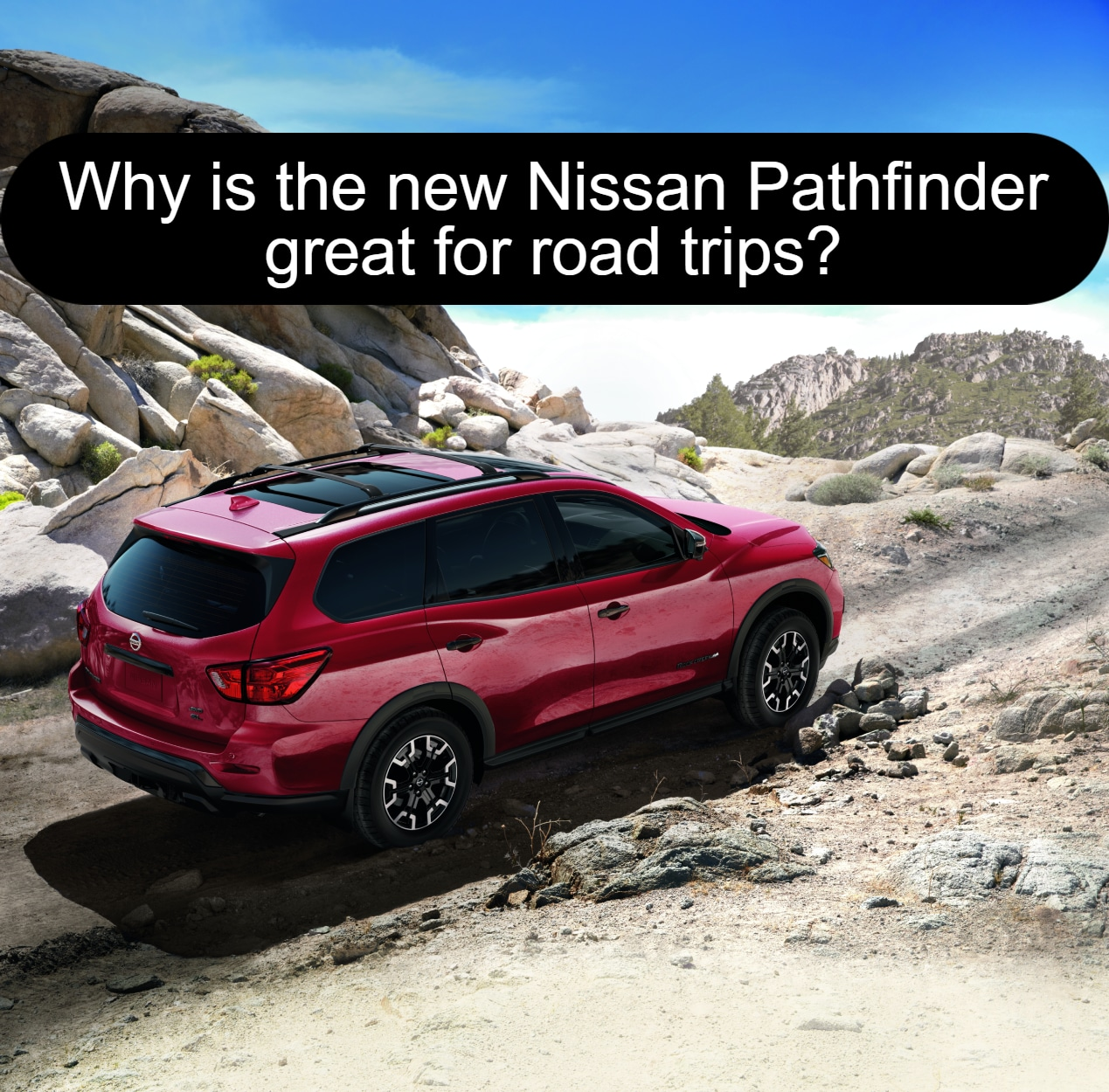 Red Nissan Pathfinder SUV going uphill off road