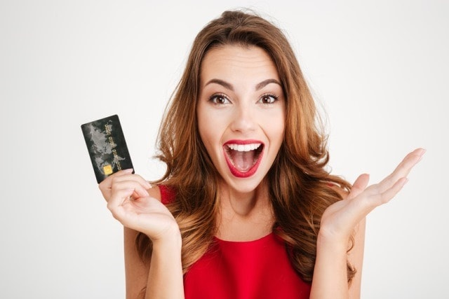 Happy woman using a credit card