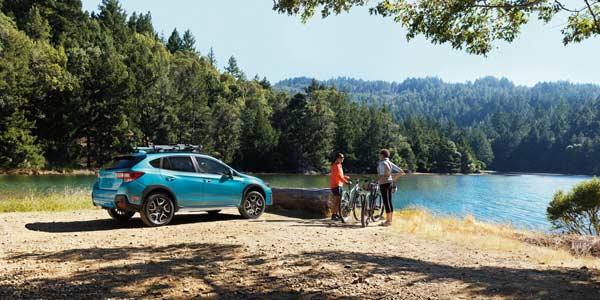 Crosstrek with cyclists at a lake