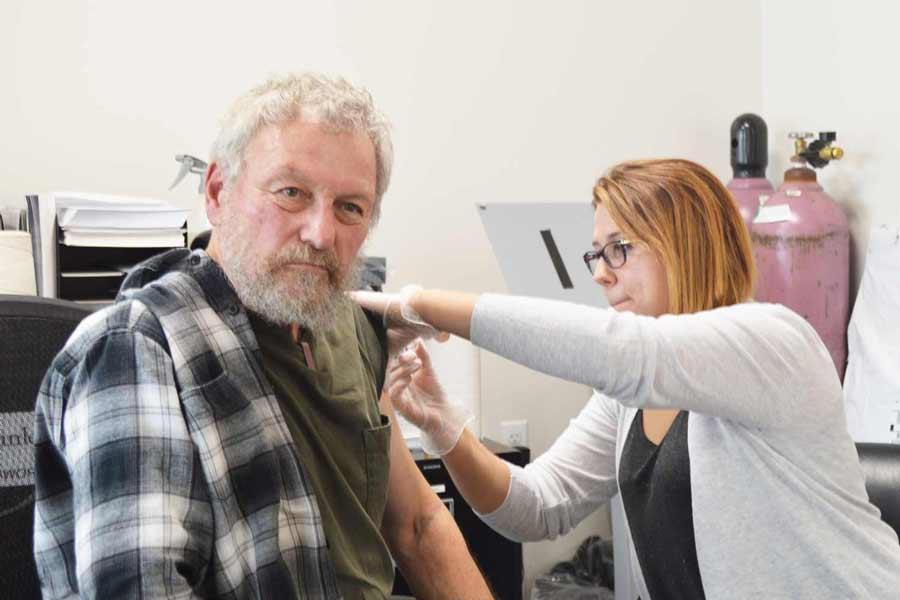 A guest gets his flu shot