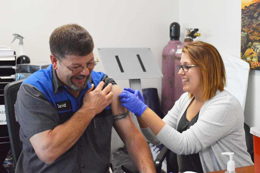 Parts Manager David getting his flu shot