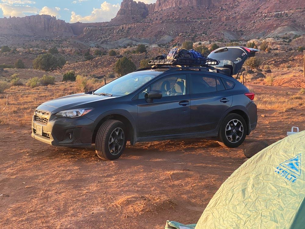 Crosstrek near sunset in front of some mesas