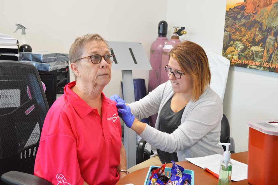 A guest gets her flu shot on us!