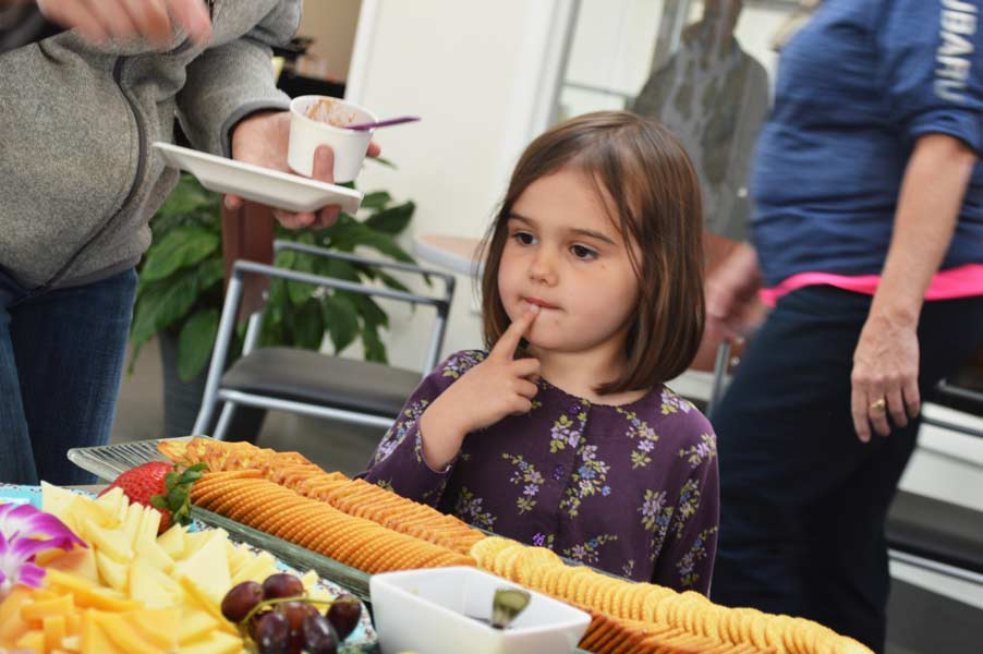 Child choosing her party platter
