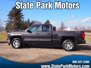Used cars, trucks, and SUVs 2015 Chevrolet Silverado 1500 4X4 Double Cab LT Truck Double Cab 366743 for sale near you in Wintersville, OH
