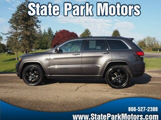 Used cars, trucks, and SUVs 2015 Jeep Grand Cherokee 4X4 Altitude SUV 149830 for sale near you in Wintersville, OH