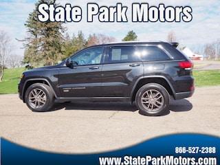 Used cars, trucks, and SUVs 2016 Jeep Grand Cherokee 4X4 Laredo SUV 413834 for sale near you in Wintersville, OH
