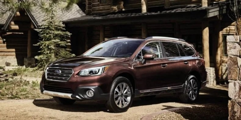Subaru Outback Hybrid Parked in Front of Cabin