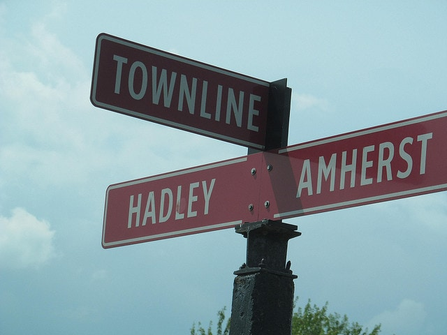 sign marking the city line between Amherst and Hadley, MA