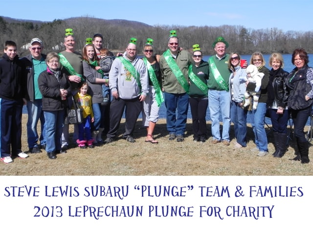 Steve Lewis Subaru Team Poses for Photo with Families