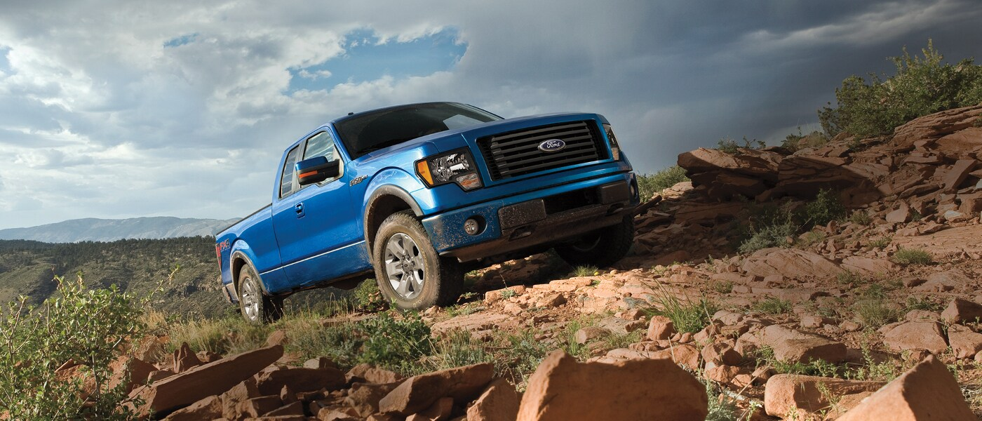 Blue 2014 Ford F-150 on cliff