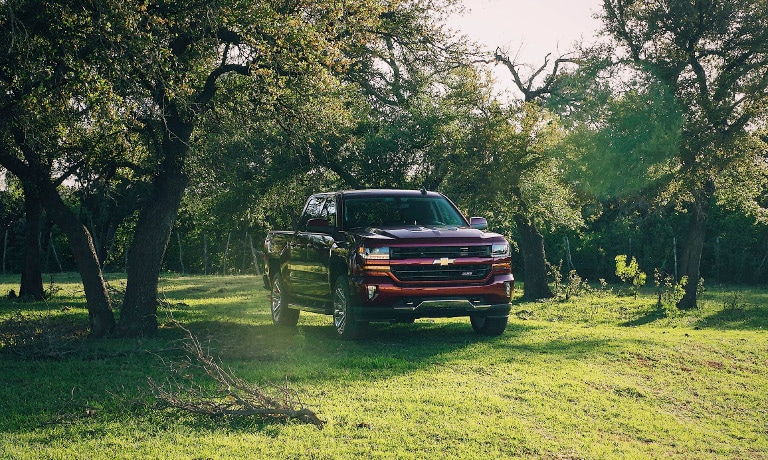 Red 2018 Chevy Silverado in field