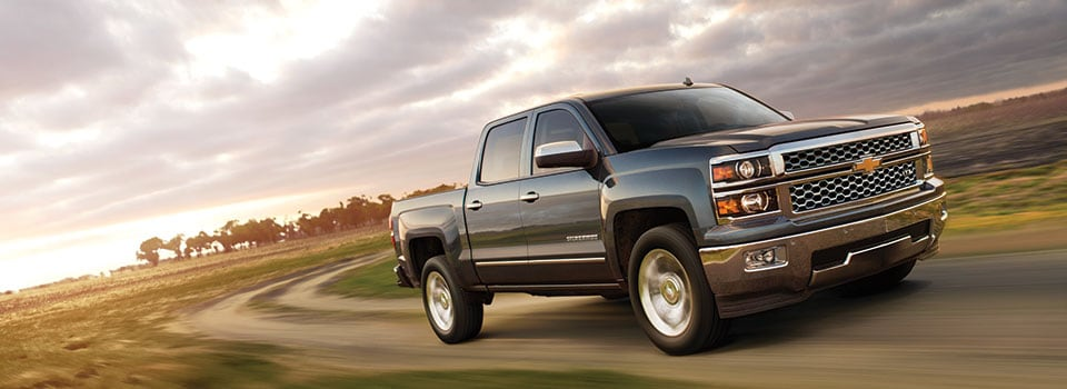 2014 Chevy Silverado driving during a sunset