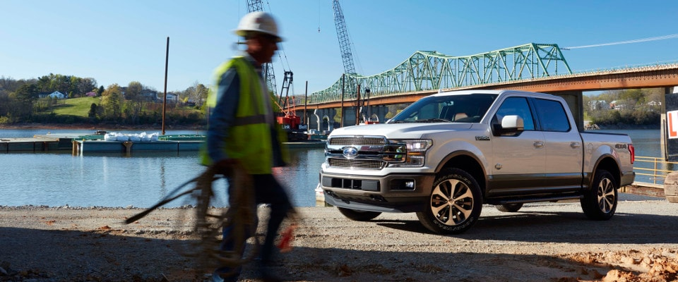 White 2019 Ford F-150 on construction site sideview