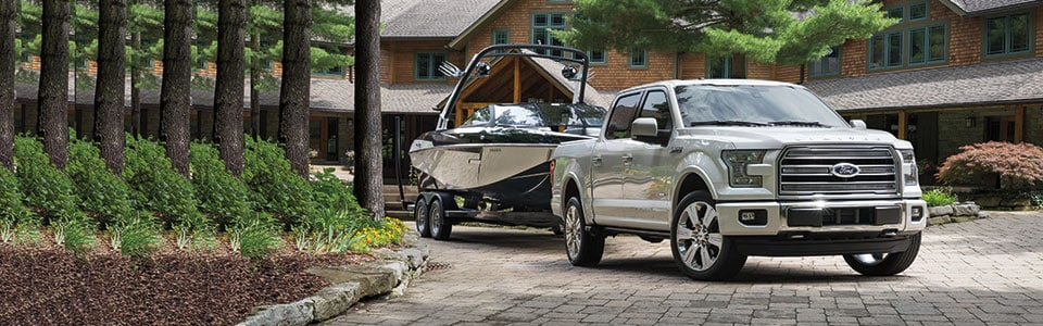 2016 Ford F-150 towing boat by house
