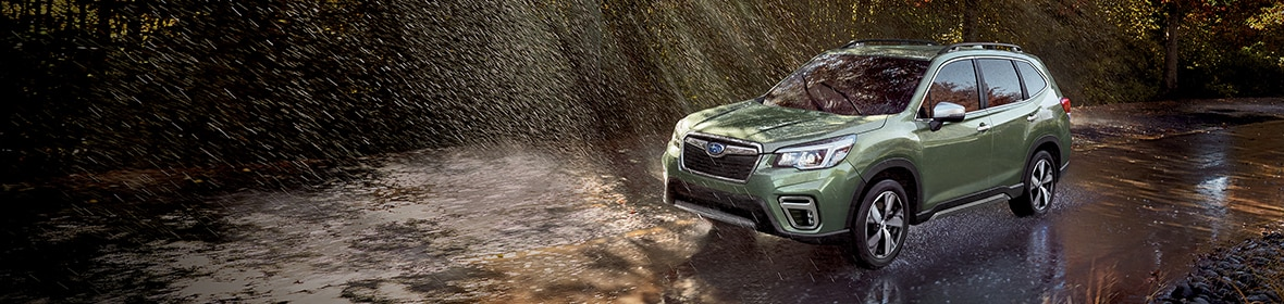 New Subaru Forester driving in the rain