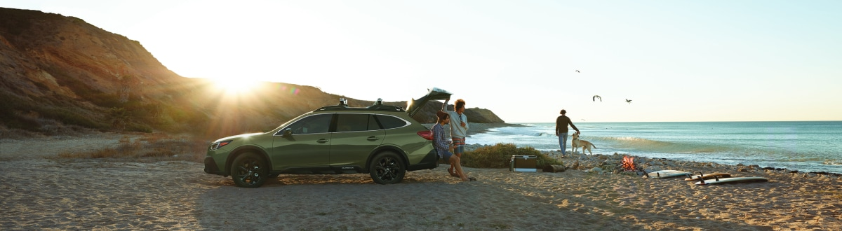 New Subaru Outback on the beach with people