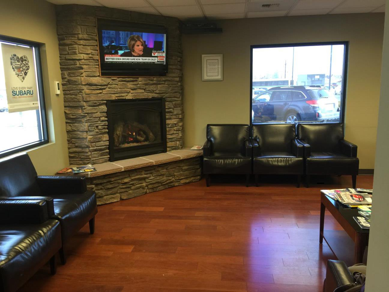Stewart Subaru waiting area with a fireplace