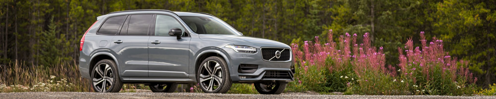New Volvo XC90 in the mountains with flowers