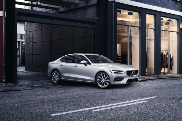 New Volvo S60 driving out on the street