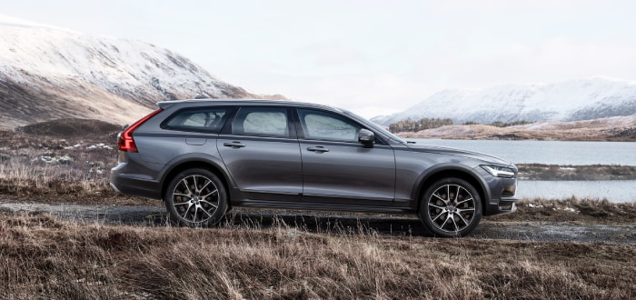 New Volvo Cross County next to a lake in the mountains